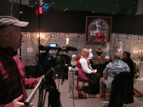 Getting ready for the next shot on the set of the studio.